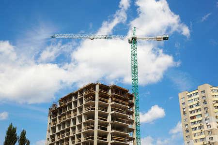 constructing: Crane constructing the building
