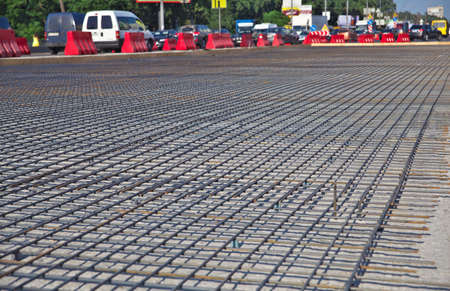 Renewal of the asphalt paving on the road  metal grid on the concrete base Stock Photo - 21776142