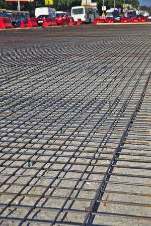 Renewal of the asphalt paving on the road  metal grid on the concrete base Stock Photo - 21776143