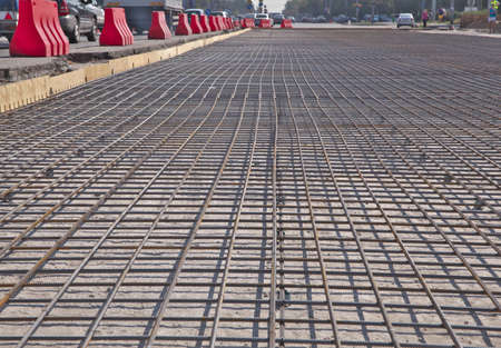 Renewal of the asphalt paving on the road  metal grid on the concrete base Stock Photo - 21776146