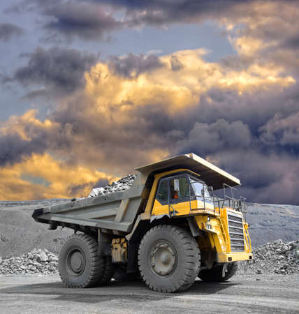 iron works: Heavy mining truck driving through the iron ore opencast