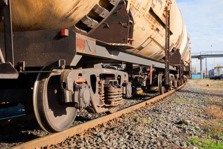 Cargo train with tank cars on the track photo