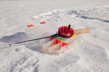 Ice fishing rod and accessories photo