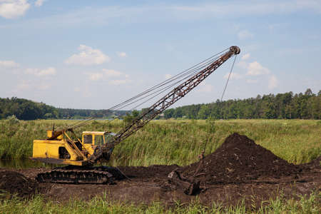 dragline: Old dragline (excavator) on the peat quarry in the swamp Stock Photo