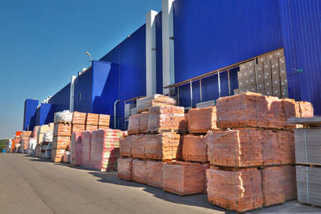 material: Construction materials stacked near the warehouse
