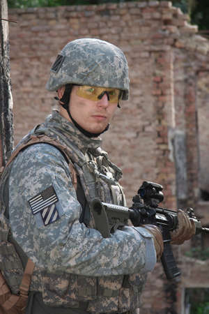 army soldier: US Soldier on urban patrol mission Stock Photo