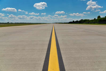 Empty airport runway (taxiway) photo