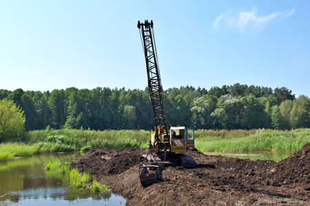 Old dragline mining the peat on the swamp photo