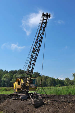 dragline: Old dragline mining the peat on the swamp Stock Photo