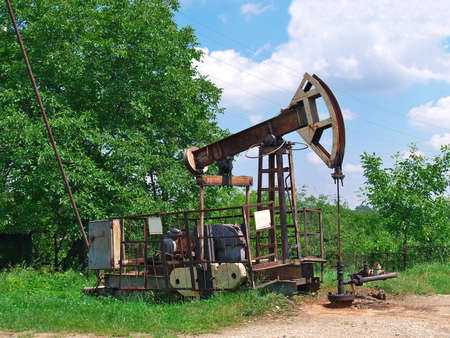 drilling well: Old oil pump jack on the oil well