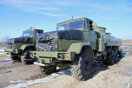 Army fuel trucks in the field depot Редакционное