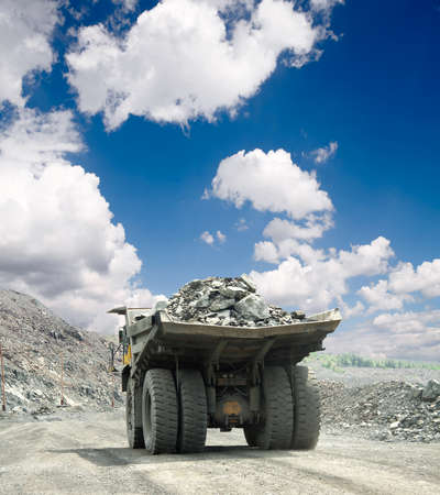 ore: Heavy dump truck carrying the iron ore on the opencast mining