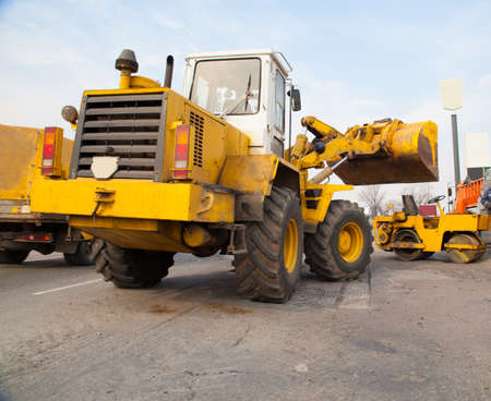 front loader: Front loader on the road repair works