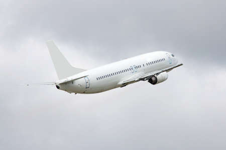 airport runway: Passenger is taking off from the runway in the airport