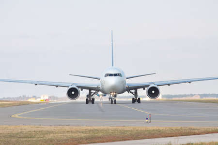 Passenger jet plane on the runway in the airport front view 스톡 콘텐츠