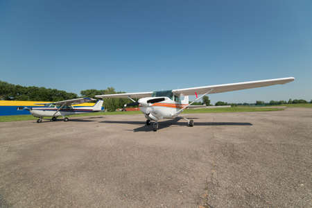 airfield: Two light planes parked on the private airfield in summer Stock Photo