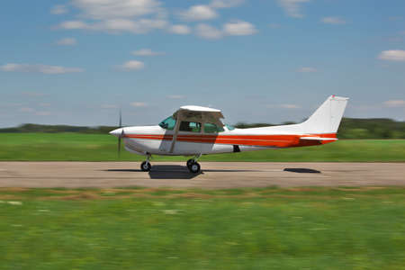take off: Light plane moving fast along the runway