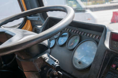 truck driver: Truck cabin interior close up view - steering wheel and dashboard Stock Photo