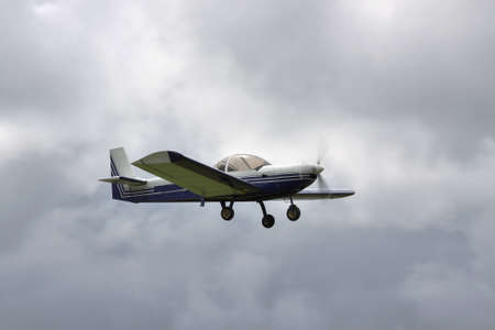 private plane: Small private plane flying during stormy weather