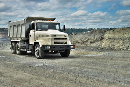 Poltava Region, Ukraine - June 26, 2010: mining truck driving on the iron ore opencast