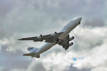 747 400: Borispol, Ukraine - October 2, 2011: El Al Israeli Airlines B747 taking into cloudy sky