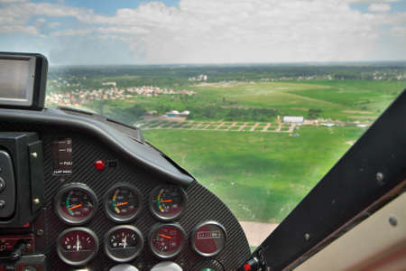 avionics: Small private plane cockpit - view to the airfield from the co-pilots seat
