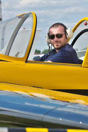 aerobatic: Pilot of a small aerobatic plane sitting in the cockpit