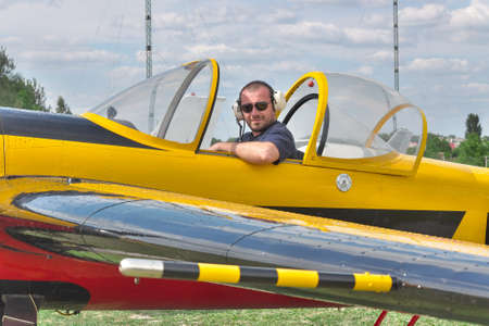 aerobatic: Pilot sitting in the cockpit of a light aerobatic plane