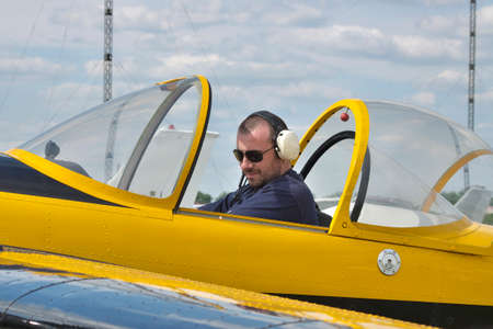 aerobatic: Pilot starting the engineof a light aerobatic plane