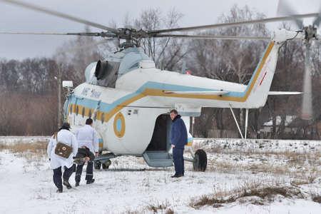 safety: Nezhin, Ukraine - January 14, 2011: Ukrainian Ministry of Emergency Situations Mi-8 helicopter during a medevac training