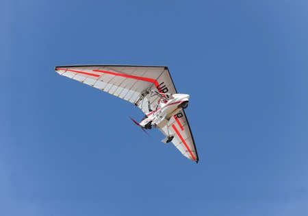 pilot light: Odessa, Ukraine - August 27, 2011: Air trike flying in nlue sky