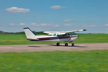 private plane: Small private plane is taking off on a sunny day Stock Photo