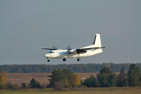 turboprop: Regional turboprop passenger plane on short final landing