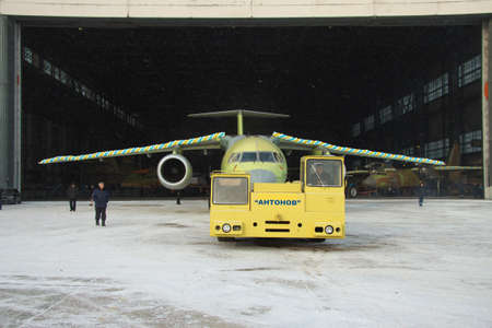 towed: Kiev, Ukraine - December 30, 2012: Antonov An-148 regional passenger jet is towed out of assembly hangar for the first time Editorial