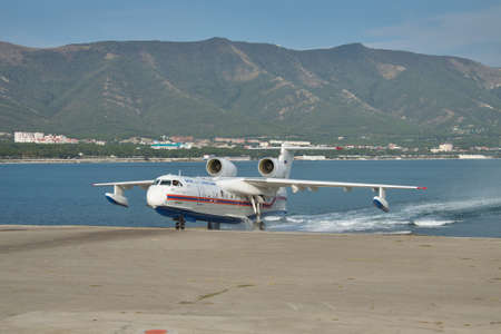 hydroplane: Gelendzhik, Russia - September 8, 2010: Beriev Be-200 rescue and firefighter sea plane taxiing out of the water to apron Editorial
