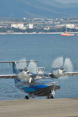 hydroplane: Gelendzhik, Russia - September 8, 2010: LA-8 sea plane after taxiing ouf of the water to the apron Editorial
