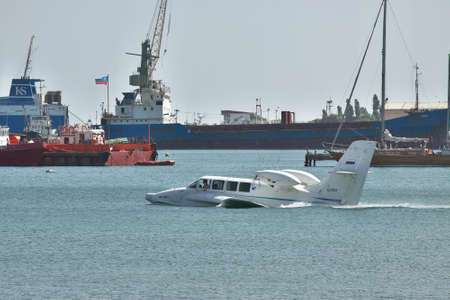 hydroplane: Gelendzhik, Russia - September 8, 2010: Beriev Be-103 sea plane on water surface in the port