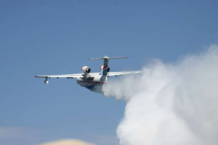 hydroplane: Gelendzhik, Russia - September 9, 2010: Beriev Be200 multipurpose amphibian plane showing its firefighting water dropping abilities Editorial