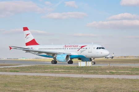 airways: Borispol, Ukraine - October 23, 2011: Austrian Airways Airbus A320 is taxiing to the runway