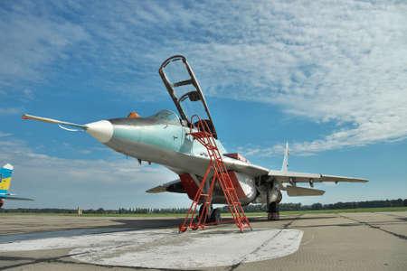 mig: Vasilkov, Ukraine - June 19, 2010: Ukrainian Air Force MiG-29 fighter plane parked on the apron on the airbase preparing for a training flight Editorial
