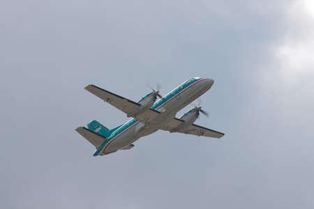 turboprop: Borispol, Ukraine - October 2, 2010: Saab 340A regional plane is taking after the rain Editorial