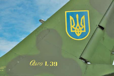 aero: Vasilkov, Ukraine - June 19, 2010: Ukrainian Air Force signs on the tail fin of a training aircraft Aero L-39 Albatros