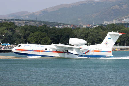 animals amphibious: Gelendzhik, Russia - September 8, 2010: Beriev Be-200 amphibian cargo and firefighter plane is getting out of the water to the ramp