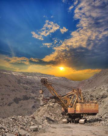 ore: Large exavator on the iron ore opencast on sunset