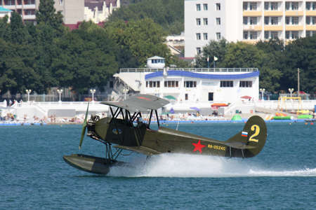 hydroplane: Gelendzhik, Russia - September 9, 2010: Polikarpov Po-2 vintage biplane is taking off from water surface of the bay