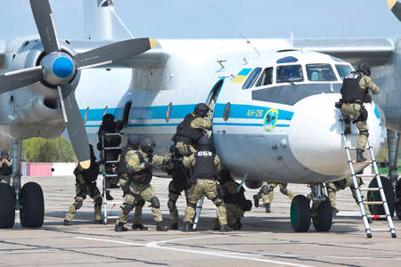 special operations: Kiev Region, Ukraine - April 24, 2012: Special operations sercice squad during the counter-terrosist training with a captured plane