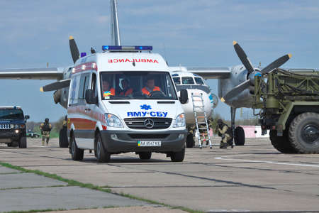 evacuating: Kiev Region, Ukraine - April 24, 2012:Ambulance is evacuating the victims during the Special operations sercice squad at the counter-terrosist training with a captured aircraft