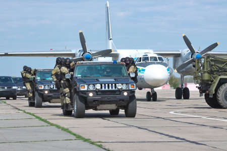 special operations: Kiev Region, Ukraine - April 24, 2012: Special operations sercice squad during the counter-terrosist training riding Hummer H2 SUVs