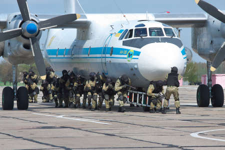 special operations: Kiev Region, Ukraine - April 24, 2012: Special operations sercice squad during the counter-terrosist training with a plane