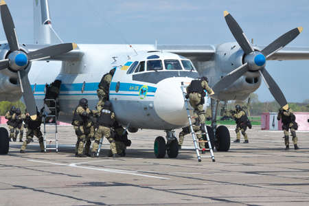 captured: Kiev Region, Ukraine - April 24, 2012: Special operations sercice squad during the counter-terrosist training with a captured plane in the airport Editorial